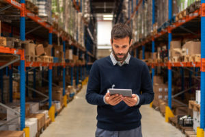 Using Tracmor in a warehouse to manage inventory on a Windows, iPhone, or Android tablet.